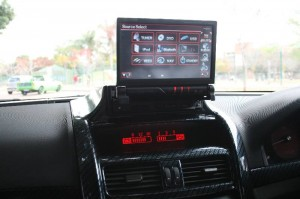 The dvd player in a custom carbon fibre installation